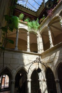 Gothic cloister with well in the Antic Hospital de Santa Magdalena, Montblanc, Catalonia
