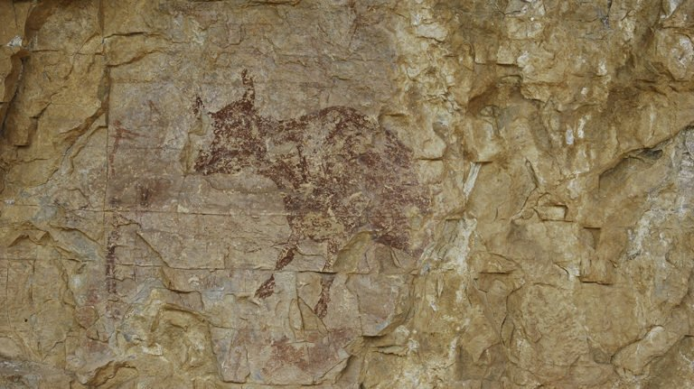 Rock art in rock shelter. Scene with hunters and cow. Abric del Mas d'en Ramon d'en Bessó, Muntanyes de Prades