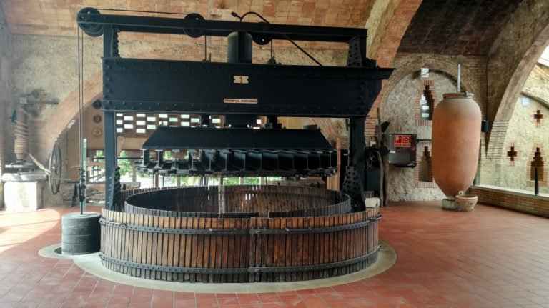 Old wine press and amphora, Codorníu winery exhibition hall