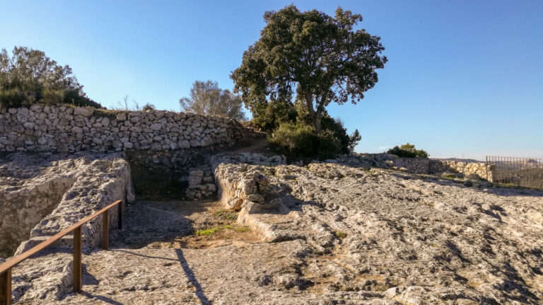 Medieval wine press and cellar (11th-12th century), with medieval town wall (10th century) at image right, Olèrdola monumental complex