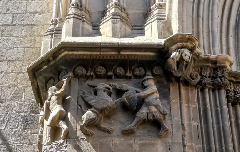 Sculpture detail on Barcelona Cathedral, Gothic Quarter. St. George slaying a dragon