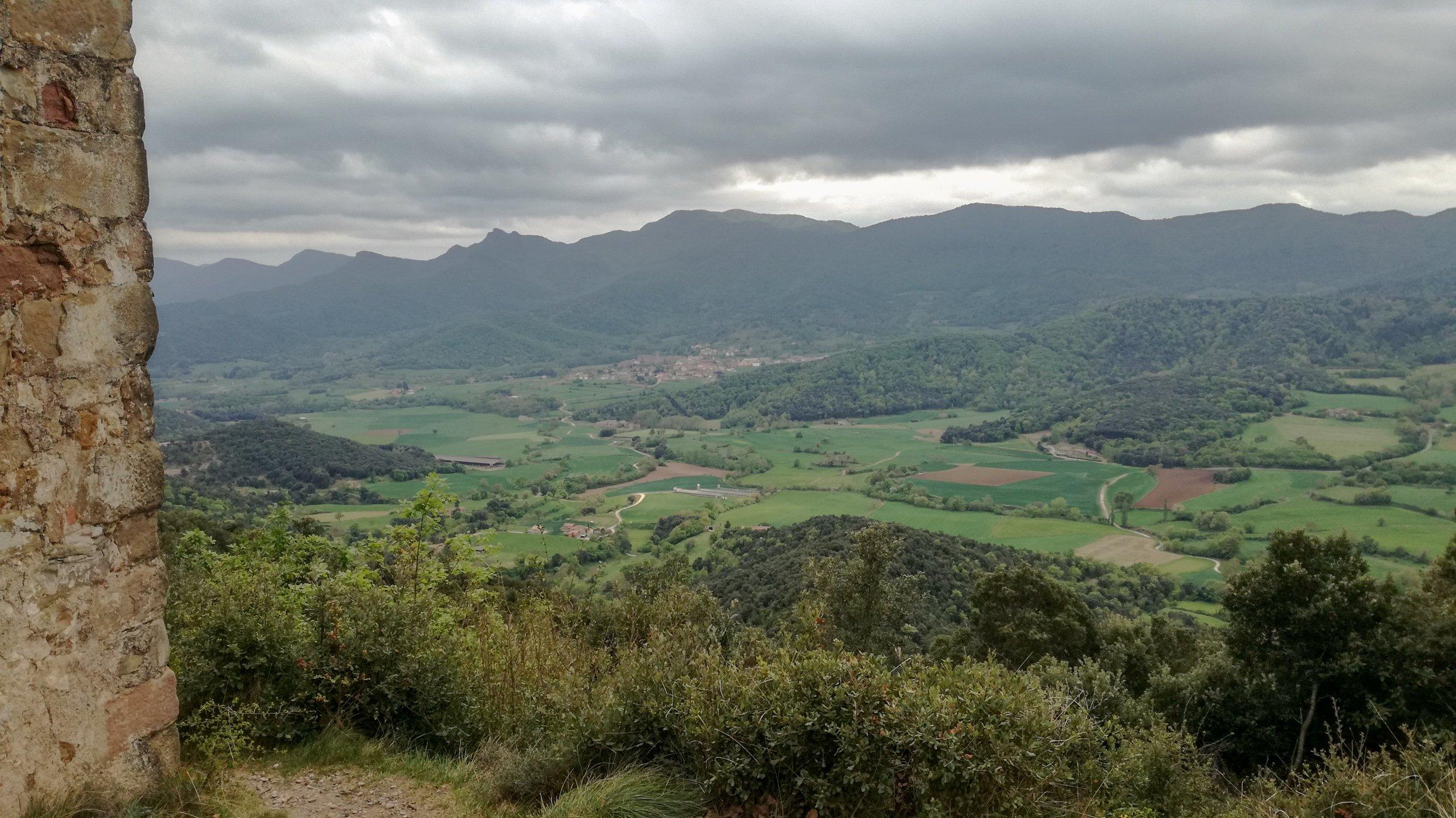 Garrotxa Hike trail, looking down at extinct volcanos from the Sant Abdó i Sant Senen de Santa Pau chapel on Coll de Boixeda hill