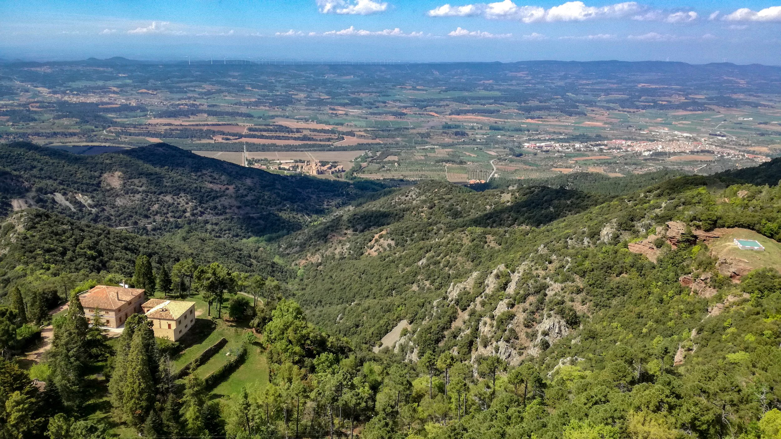 Poblet to de la Pena, Prades Mountains Hike. View from summit looking down to Poblet Monastery in the valley below