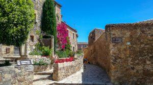 Springtime flowers, streetscape, Pals medieval town, Baix Empordà, Catalonia