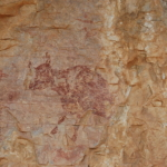 Rock art in rock shelter. Scene with hunters and cow. UNESCO site of Abric del Mas d'en Ramon d'en Bessó, Muntanyes de Prades, Catalonia